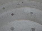 Pool resurfacing. It is a pebble-like material: Premix Marbletite Freestone Marquis Series, color Tunisia