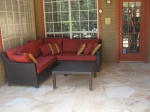 Dean's favorite find: a sectional that fits perfectly in the corner of our upper patio.